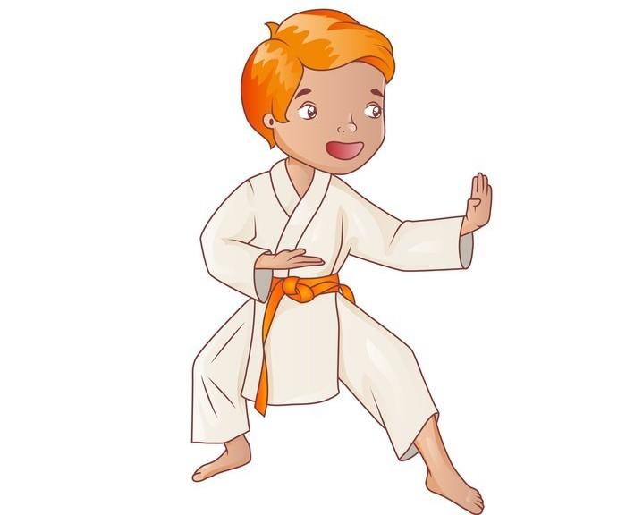Little boy wearing kimono practicing karate